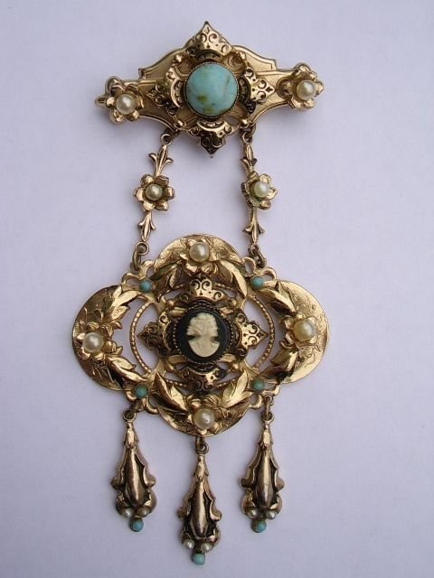 a magnificent rolled gold early victorian cameo ladies pendant broach decorated with leafed foliage set with pearls cabochon turquoise blue stones